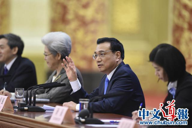 两会闭幕:中国经济谋势做活两手抓(组图)